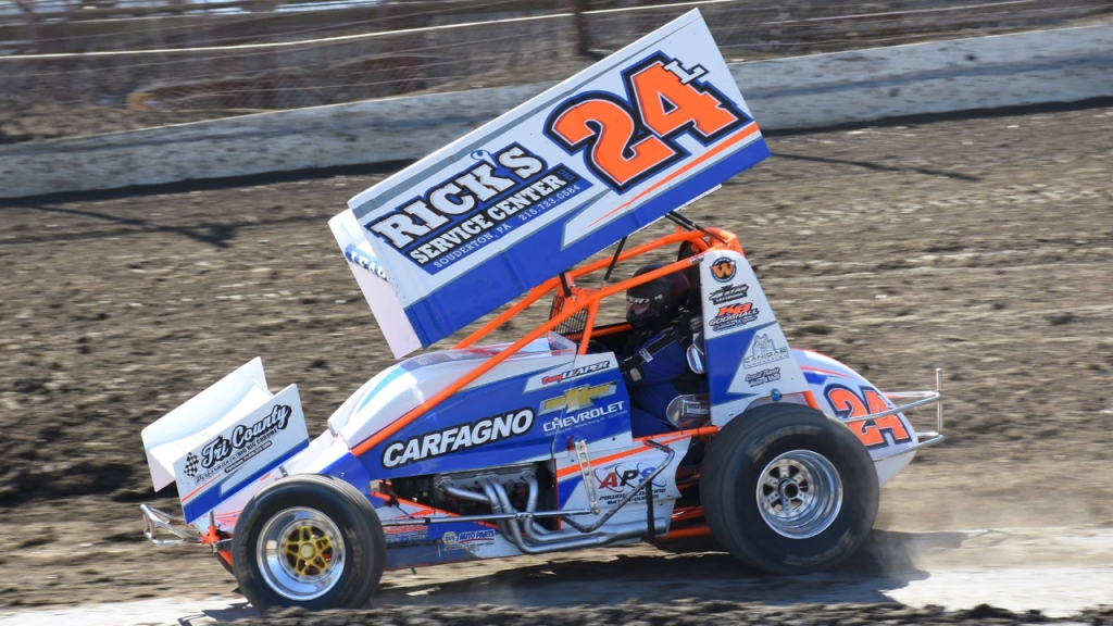 Sprint Car driver Dan Leaper driving his Rick's Service Center and Carfagno Chevrolet sponsored ride around the track