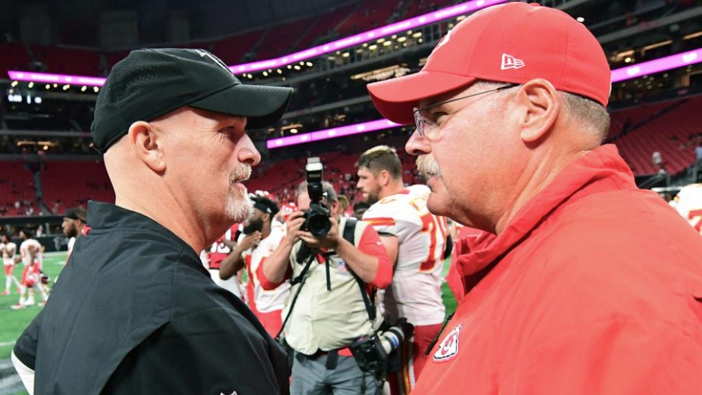 Former Atlanta Falcons head coach Dan Quinn shakes hands with Kansas City Chiefs head coach Andy Reid after their preseason game