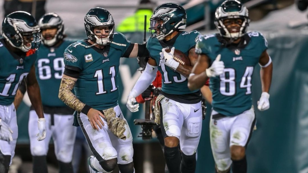 Disgruntled Philadelphia Eagles quarterback Carson Wentz celebrates with his teammates following a touchdown