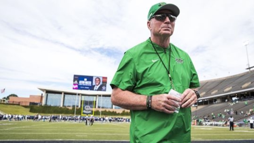 "Former Marshall Thundering Herd head football coach John ""Doc"" Holliday on the field before a game"