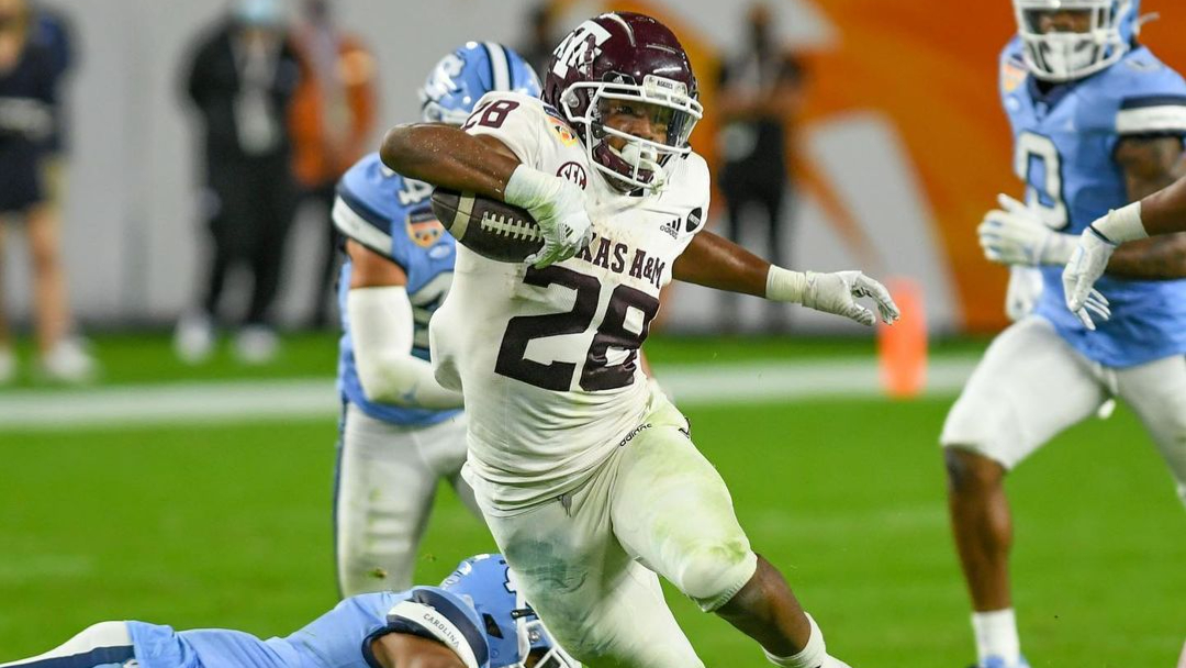 Texas A&M Aggies running back Isaiah Spiller carries the football against the North Carolina Tar Heels in the 2021 Capital One Orange Bowl