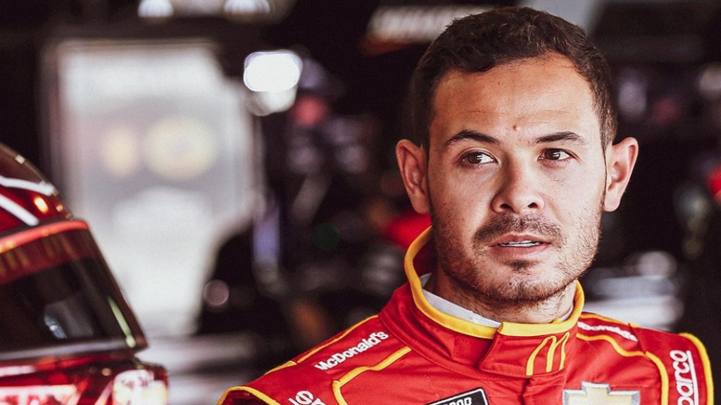 NASCAR Cup Series driver Kyle Larson in the pits with his team before the Auto Club 400