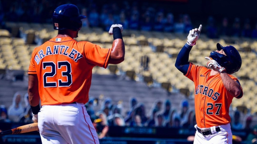 Houston Astros outfielder Michael Brantley celebrates with teammate José Altuve against the Oakland Athletics in the 2020 American League Division Series