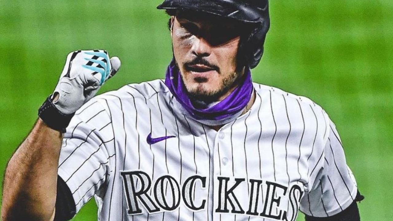 Colorado Rockies third baseman Nolan Arenado hits a home run against the San Francisco Giants