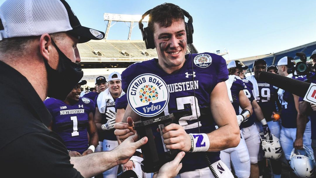 Northwestern Wildcats quarterback Peyton Ramsey receives the Vrbo Citrus Bowl MVP after guiding his team to a win over the Auburn Tigers