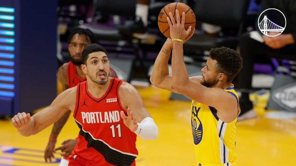 Golden State Warriors star Stephen Curry attempts a shot against the Portland Trail Blazers