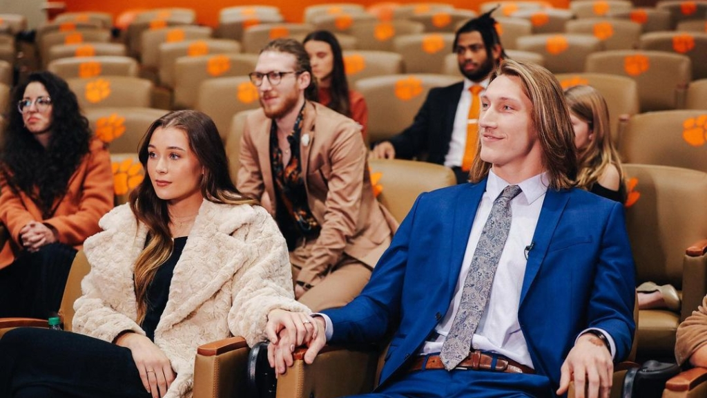 Former Clemson Tigers quarterback Trevor Lawrence sits next to his fiancée Marissa Mowry during the virtual 2020 Heisman Trophy ceremony
