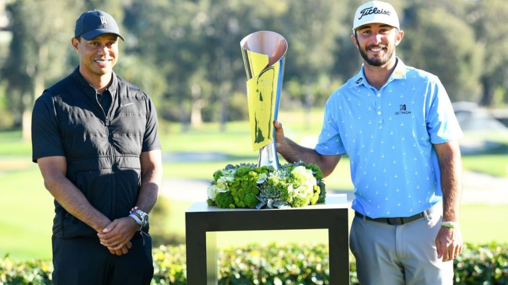 Genesis Invitational host Tiger Woods stands next to golfer Max Homa after he wins the tournament