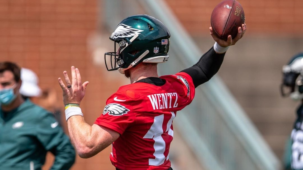 Former Philadelphia Eagles quarterback Carson Wentz attempts to throw the football during training camp