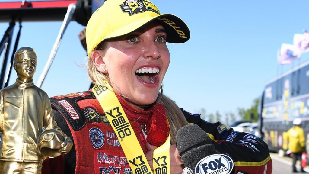 Advance Auto Parts Top Fuel Dragster pilot Brittany Force celebrates her win at the Mopar Express Lane NHRA SpringNationals presented by Pennzoil