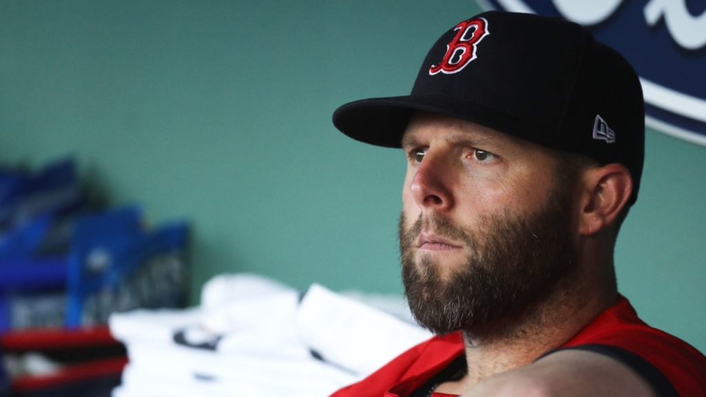 Former Boston Red Sox second baseman Dustin Pedroia looks on from the dugout against the Toronto Blue Jays