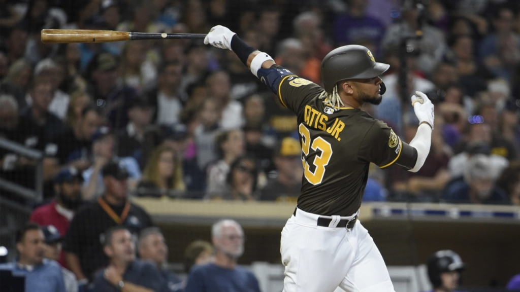 San Diego Padres shortstop Fernando Tatis Jr. hits an RBI double against the Colorado Rockies