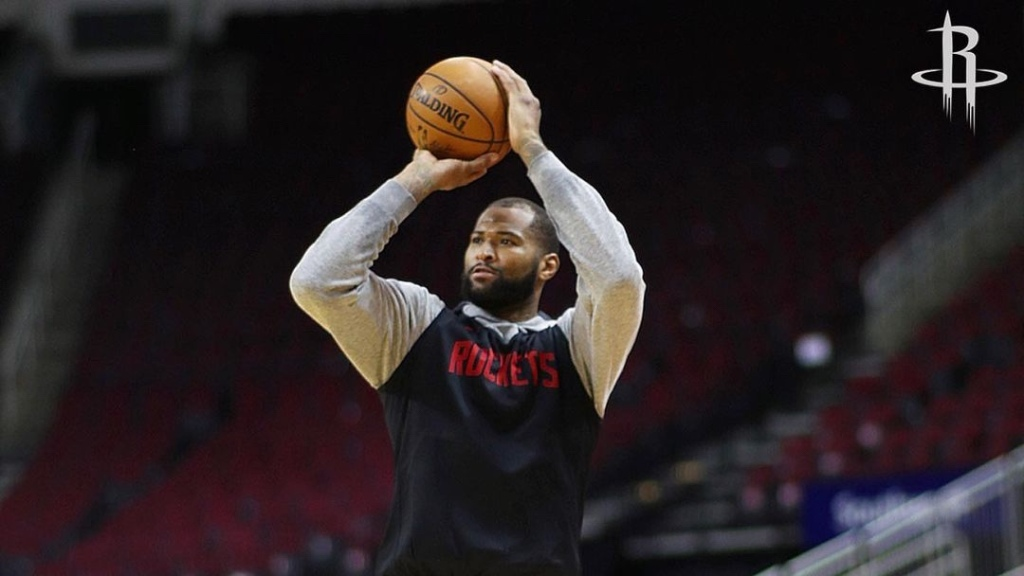 Houston Rockets center DeMarcus Cousins attempts a shot during practice