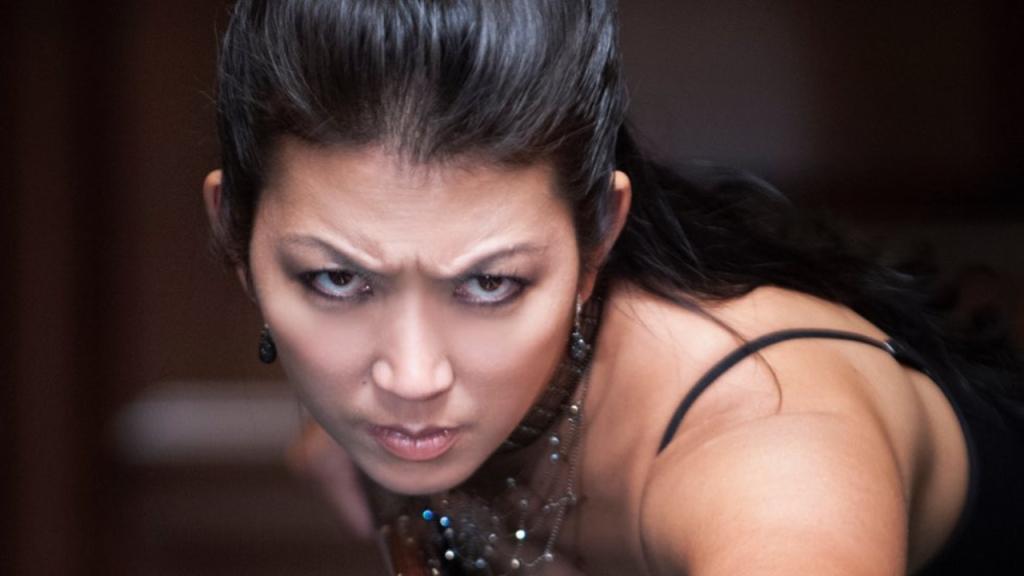"""Billiard legend Jeannette """"The Black Widow"""" Lee looks on before a billiard event"""
