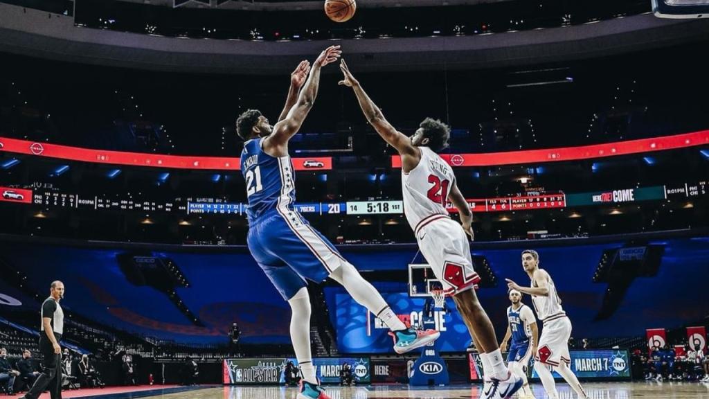 Philadelphia 76ers center Joel Embiid attempts a shot against the Chicago Bulls