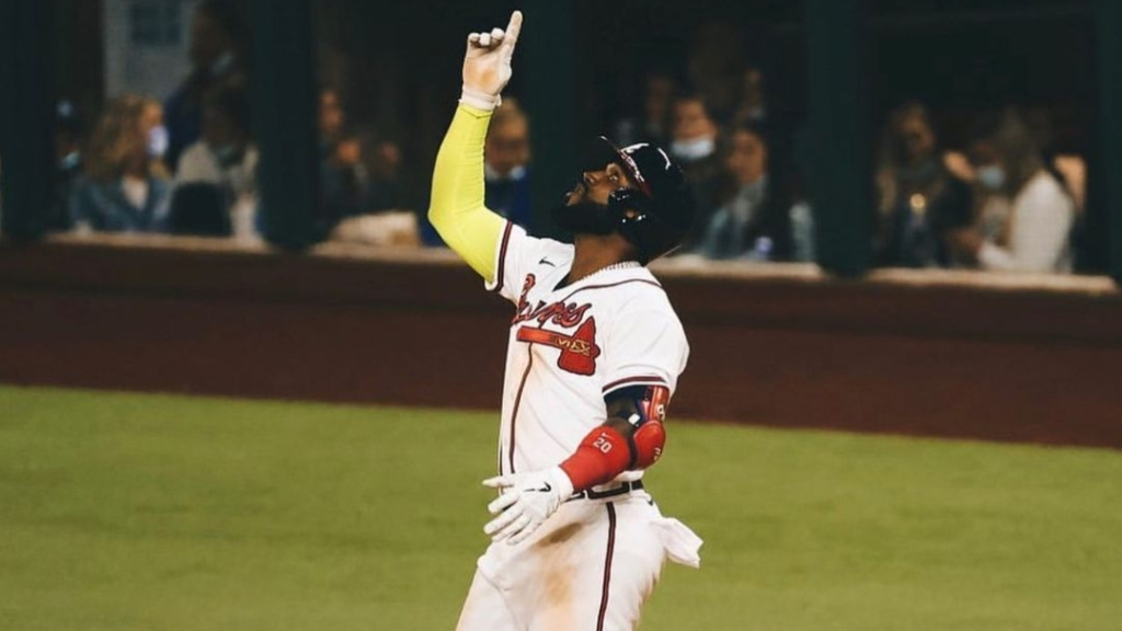 Atlanta Braves slugger Marcell Ozuna celebrates following a play