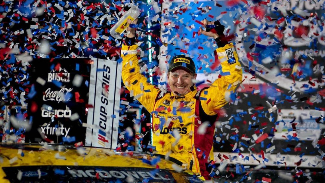 Love's Travel Shops NASCAR Cup Series driver Michael McDowell celebrates in Victory Lane after winning the 2021 Daytona 500