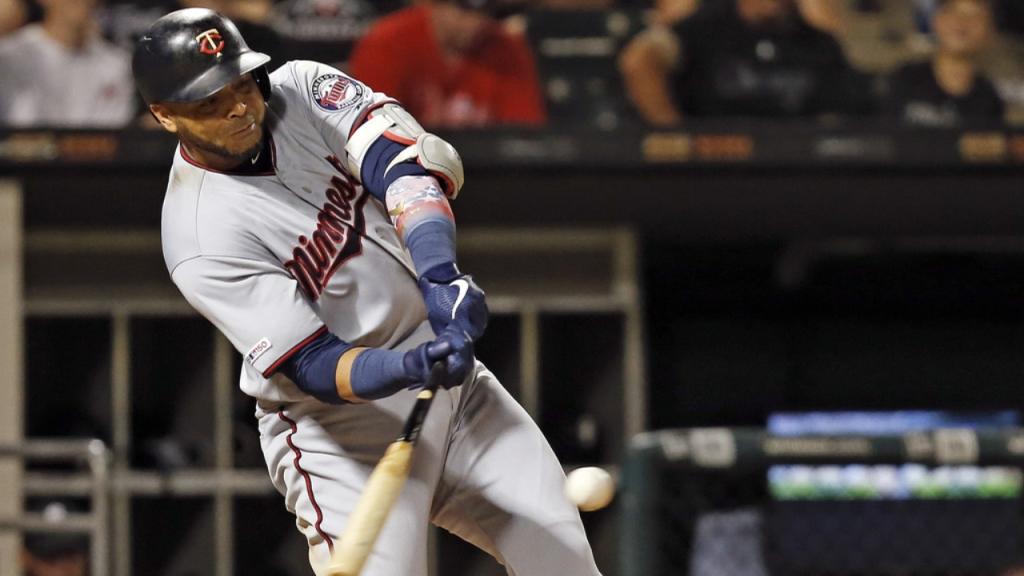 Minnesota Twins slugger Nelson Cruz hits a home run against the Chicago White Sox