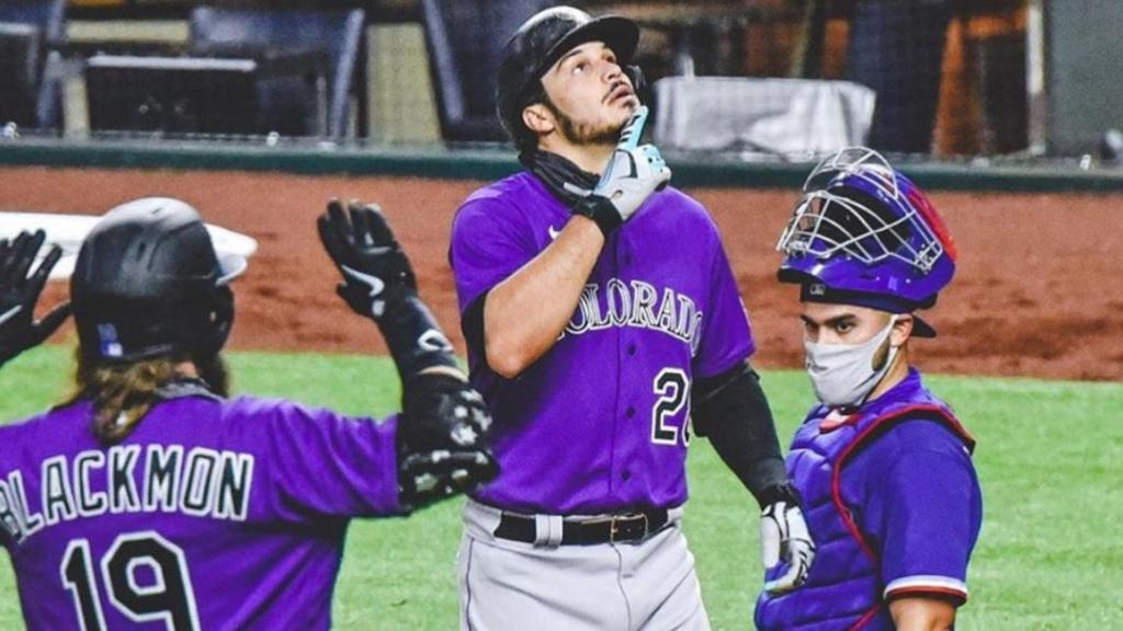 Colorado Rockies third baseman Nolan Arenado hits a home run in a spring training game against the Texas Rangers