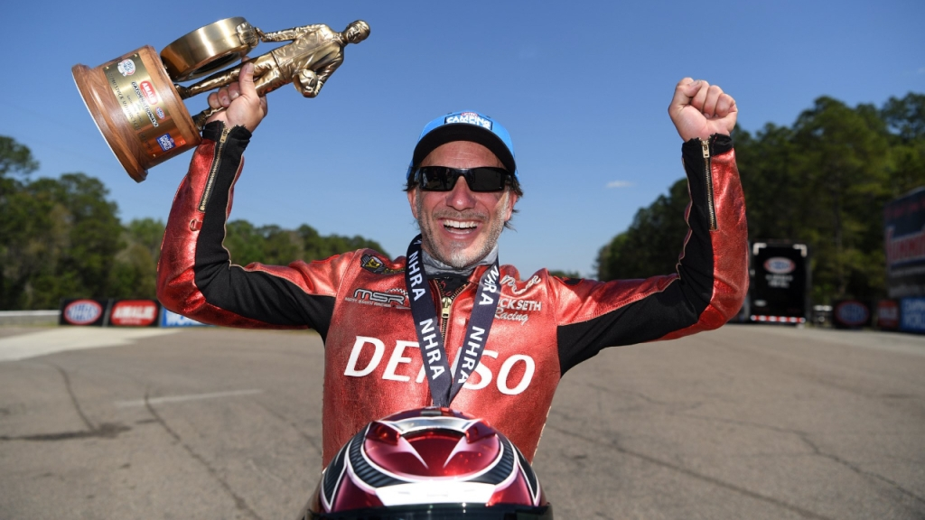 Denso sponsored Pro Stock Motorcycle rider Matt Smith celebrates his win at the 52nd annual Amalie Motor Oil NHRA Gatornationals
