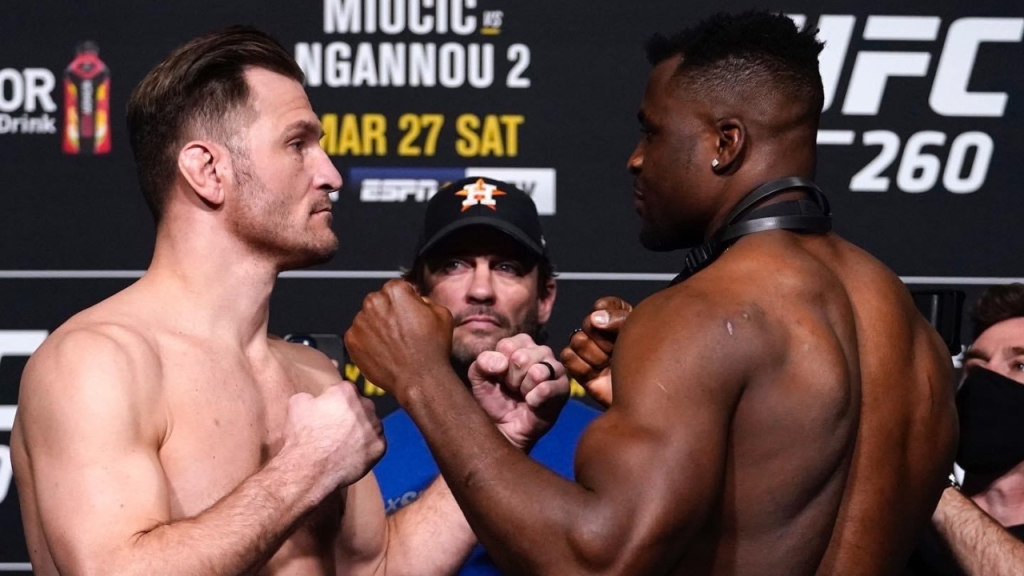 UFC Heavyweight Champion Stipe Miocic and contender Francis Ngannou face off after weigh-ins before their UFC 260 clash