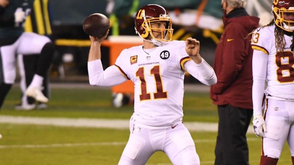 Former Washington Football Team quarterback Alex Smith warms up before their regular season finale against the Philadelphia Eagles