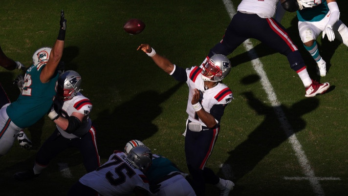 New England Patriots quarterback Cam Newton attempts a pass against the Miami Dolphins