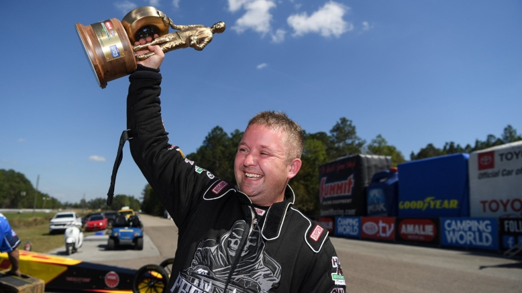 Burnyzz-sponsored Top Fuel Dragster pilot Josh Hart celebrates his win at the 52nd annual Amalie Motor Oil NHRA Gatornationals