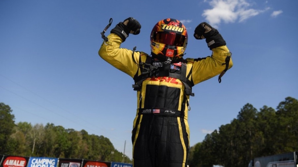 DHL-sponsored Funny Car pilot J.R. Todd celebrates his win at the 52nd annual Amalie Motor Oil NHRA Gatornationals