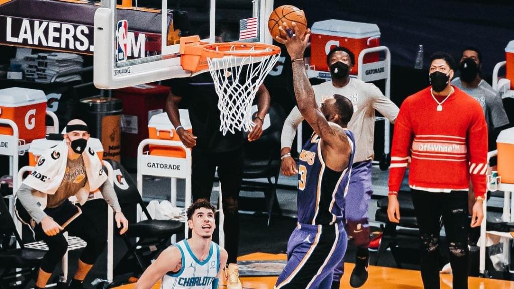 Los Angeles Lakers superstar LeBron James dunks against the Charlotte Hornets
