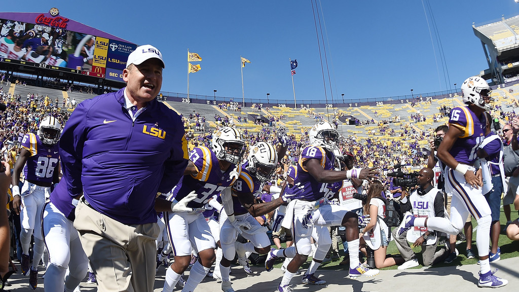 Former LSU Tigers head football coach Les Miles takes the field with his team against the South Carolina Gamecocks