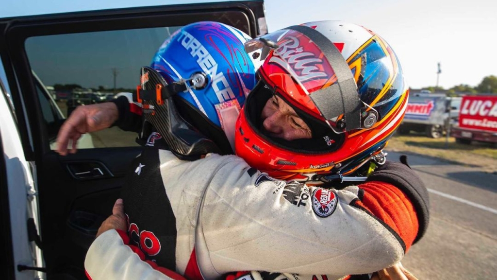 Capco Contractors Top Fuel Dragster pilots Steve and Billy Torrence hug during a national event