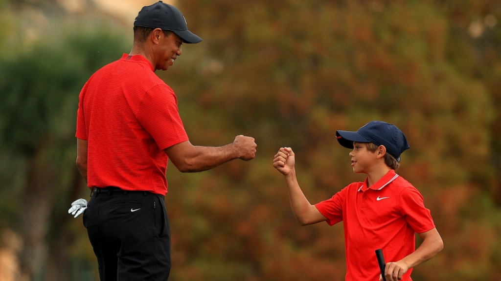 PGA icon Tiger Woods shares a moment with his son Charlie Woods on the 18th hole during the final round of the PNC Championship at the Ritz Carlton Golf Club