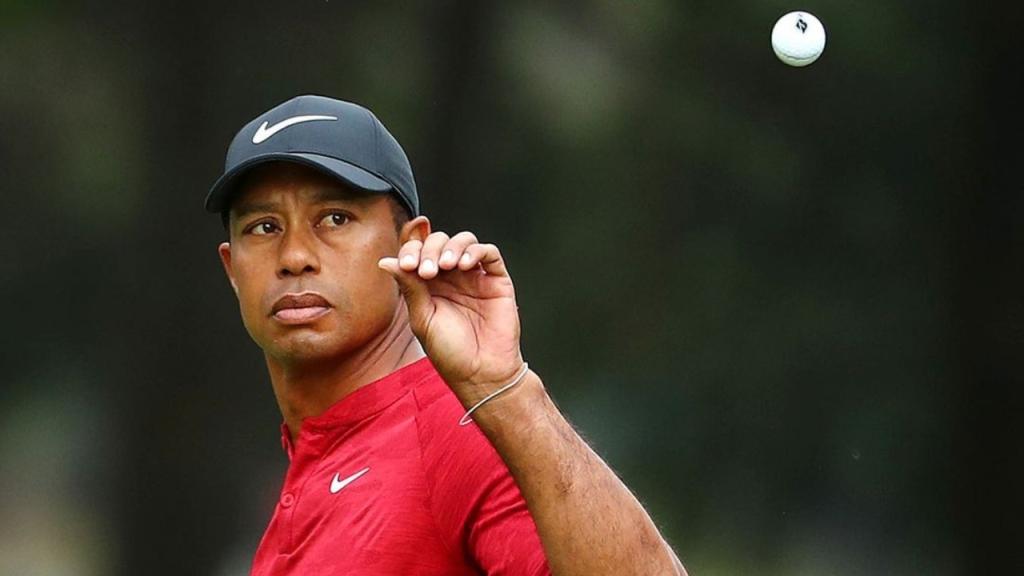 PGA golf legend Tiger Wood throws a golf ball in the air