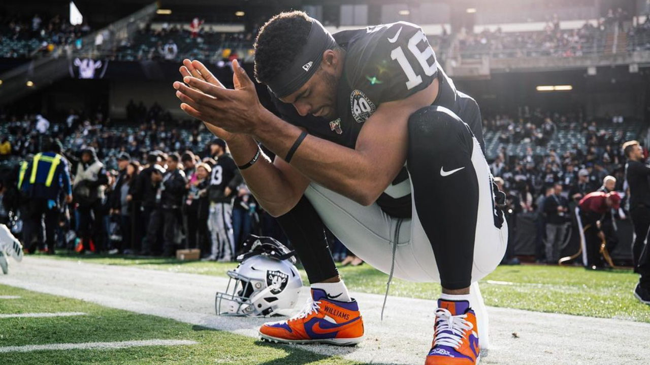 Former Las Vegas Raiders wide receiver Tyrell Williams takes a moment to himself before a game