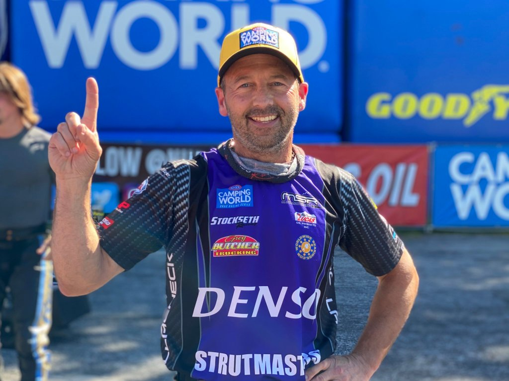 DENSO/Strutmasters/Matt Smith Racing sponsored Pro Stock Motorcycle rider Scotty Pollacheck celebrates No. 1 qualifier at the Lucas Oil NHRA Southern Nationals